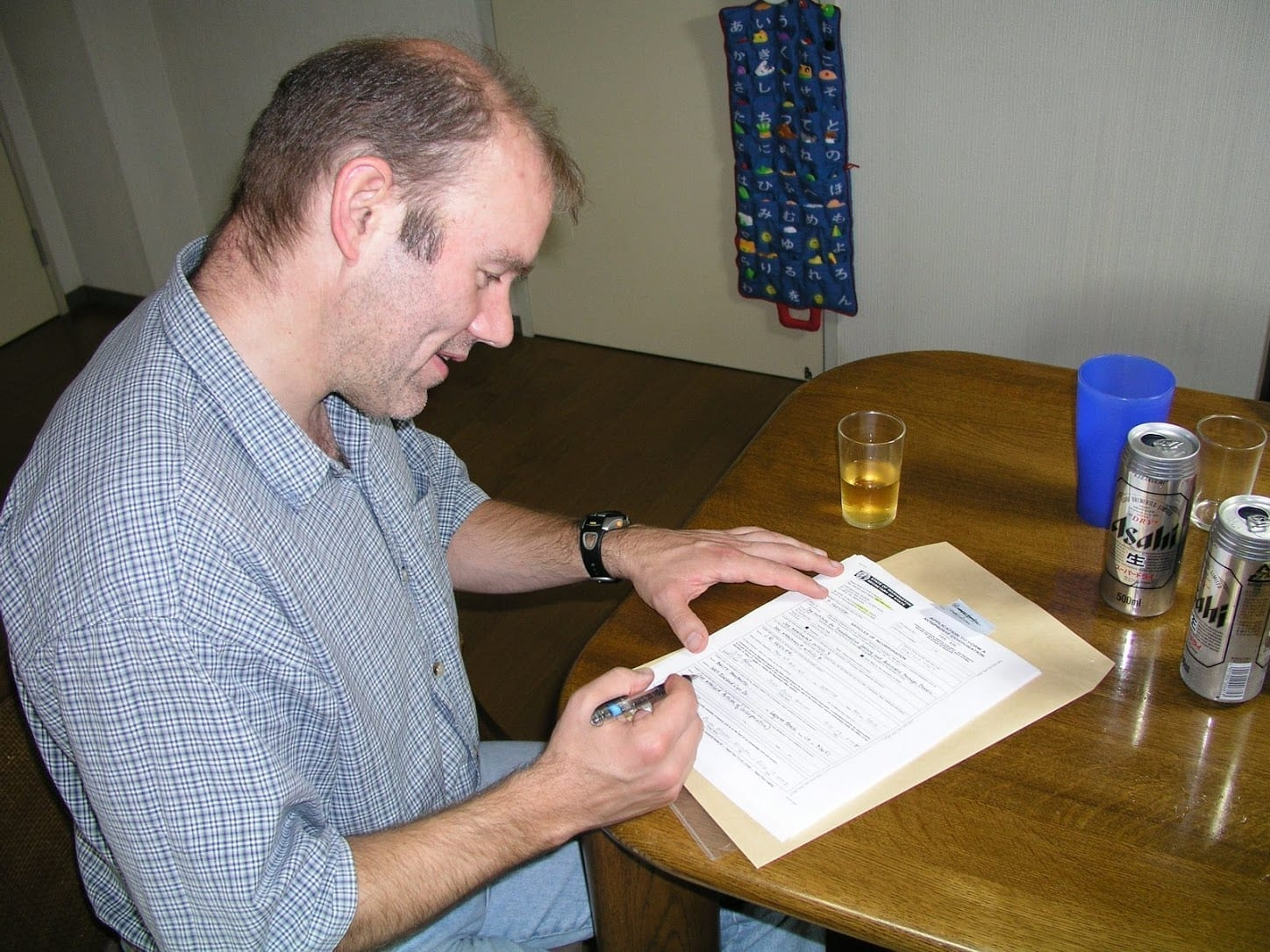 J.B. Hoover signing the Articles of Incorporation for iLEAP in 2004